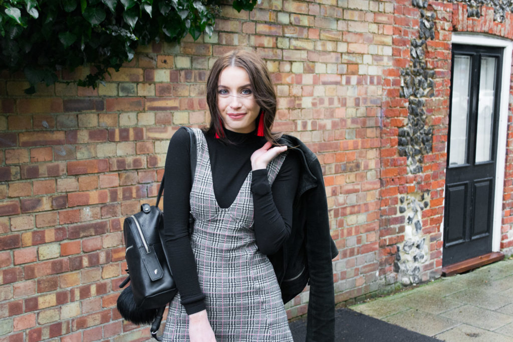 Wearing Topshop check pinafore dress, Missguided high neck body, Topshop earrings and Fiorelli Backpack.
